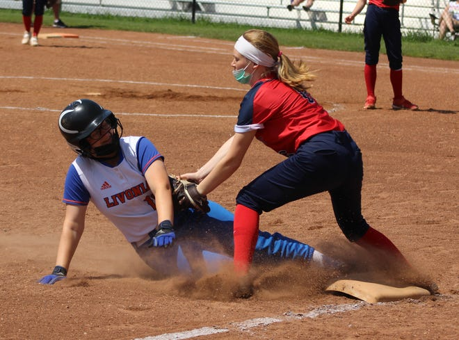 Hornell's Isabella Barnes applies the tag to a Livonia runner on Saturday morning in Hornell.