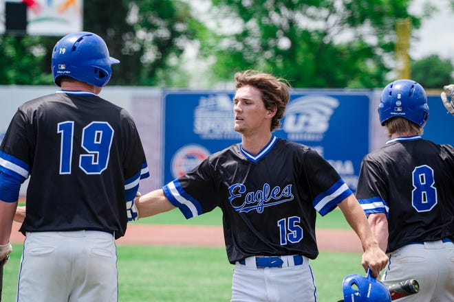 Grain Valley senior Parker Bosserman (15) is greeted by teammates Parker Stone (19) and Riley Bown (8) after scoring a run in a Class 5 state semifinal win over Rockwood Summit. Bosserman hit .504 with a school-record 63 hits, second most in state history for a single season, and had 23 extra base hits for the Eagles, who finished second in the state in Class 5. He shares The Examiner's 2021 Baseball Player of the Year award with his longtime teammate Cole Keller.