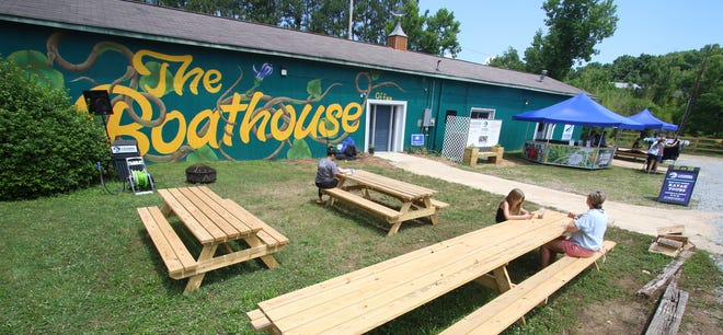 """People eat and shop outside the Catawba Riverkeeper Foundation's """"The Boathouse""""  Saturday afternoon, June 5, 2021 on Willow Drive in McAdenville."""
