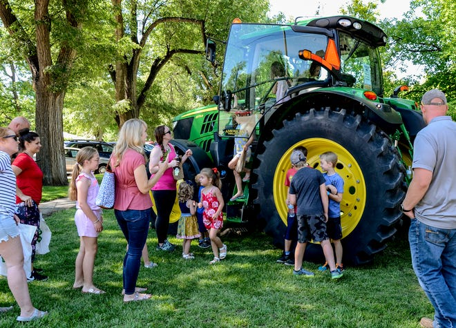 A John Deere tractor was one of the stations children could check out around the Finney County Public Library during the library's summer reading program kick-off event Friday.