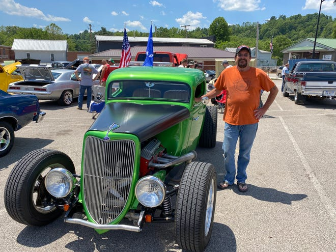 """Dozens of people showed off their antique cars in Ripley's Cavalcade of Customs event. Mike Corns, 67, poses with his 1934 Ford at the June event. He said he loves all cars, """"If it has wheels and runs, I like it."""""""