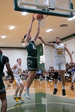 Former Algonquin basketball star Alex Karaban goes up for a dunk against the Tilton School.