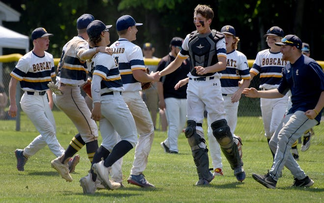 Whiteford pitcher Levi Hillard (center) is greeted by his catcher Luke Rasor after he no-hit Summerfield 8-0 in the Division 4 District final Saturday.