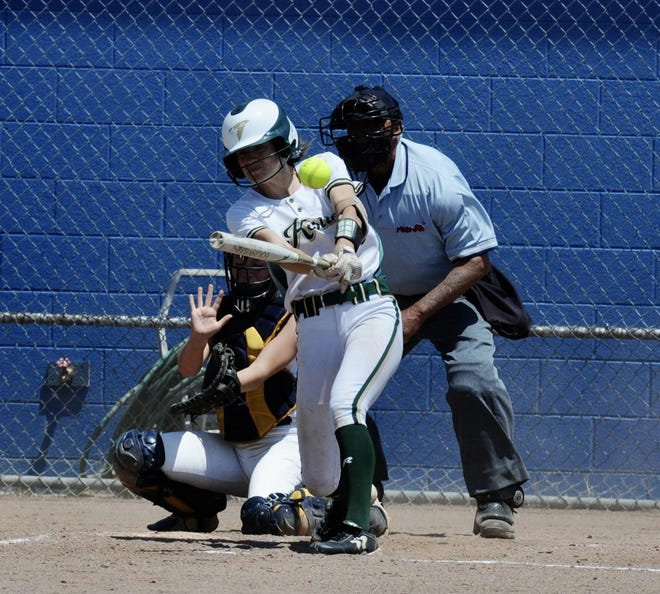 Anna Dean rips a two-run triple for St. Mary Catholic Central. The Mason catcher is Lani Stevens.