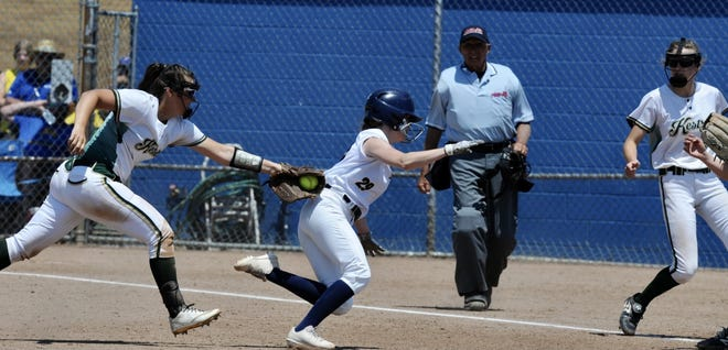 SMCC shortstop Emily Theisen tags out Cami Zaleski of Erie Mason to complete a double play Saturday.