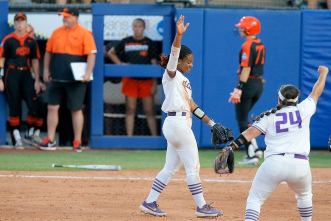 James Madison's Odicci Alexander (3) and Lynsey Meeks (24) celebrate after beating Oklahoma State on Friday night.