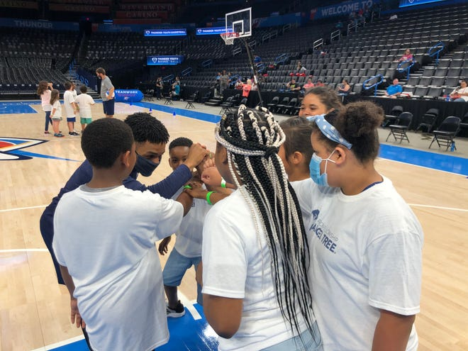 Campers huddle with a coach Saturday at Chesapeake Energy Arena.