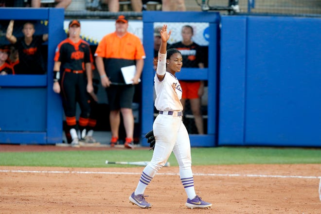 James Madison's Odicci Alexander (3) celebrates after beating Oklahoma State in a Women's College World Series softball game between the Oklahoma State Cowgirls (OSU) and James Madison University at USA Softball Hall of Fame Stadium in Oklahoma City, Friday, June 4, 2021.