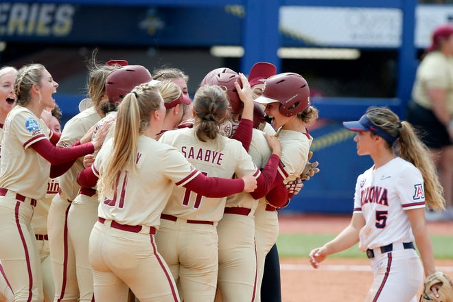 Florida State celebrates after winning a Women's College World Series softball game between the Florida State and Arizona at USA Softball Hall of Fame Stadium in Oklahoma City, Saturday, June 5, 2021. Florida State won 4-3.