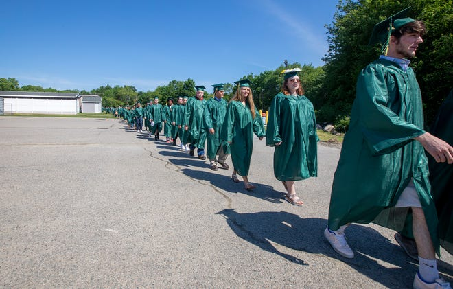 Graduating seniors marching onto the field at  South Shore Regional Vocational Technical High School's graduation on June 5, 2021.
