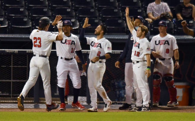 USA outfielder Luke Williams (23) celebrates his home run in the fifth inning against Canada Friday night at the Ballpark of the Palm Beaches.
