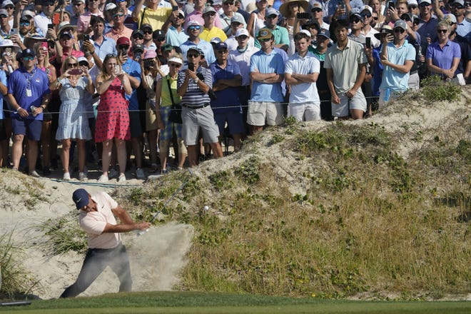 Brooks Koepka, hitting out of a bunker on the 10th hole during the final round at the PGA Championship two weeks ago, continued his feud with Bryson DeChambeau this week.