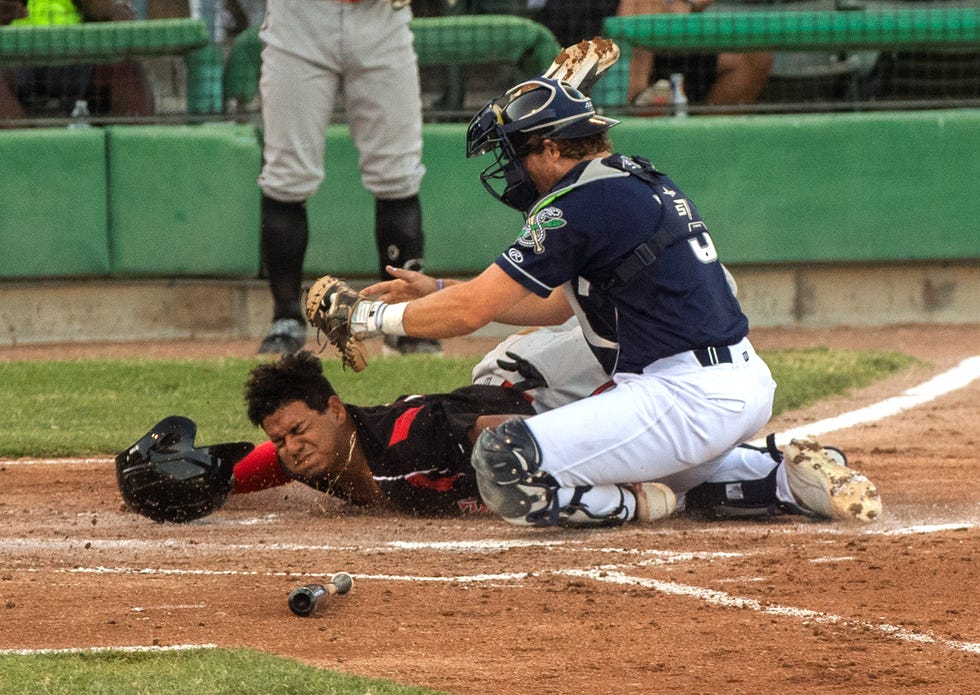 Stockton Ports catcher Cooper Uhl tags Lake Elsinore's Alison Quintero for the out at home during a California League baseball game against the Lake Elsinore Storm at Stockton Ballpark on June 4.