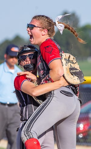 Pearl City's Cheyenne Handsaker, right, and Madyson Stephen celebrate after scoring two runs in the final inning to beat Forreston 3-2 in a Class 1A regional softball title game at Forreston on Friday, June 4, 2021.