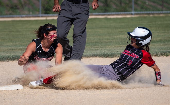 Forreston shortstop Brooke Boettner tries to tag out Pearl City's Madyson Stephen at second base in the first inning of the Forreston 1A Regional championship game on Friday, June 4, 2021.