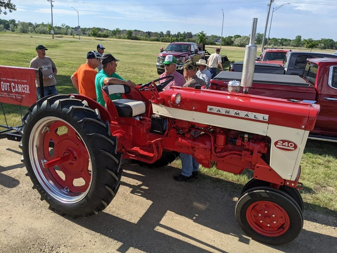 Members of the James Valley Tractor Club visit Saturday morning before leaving the Brown County Fairgrounds for their annual Drive Out Cancer tractor drive fundraiser.