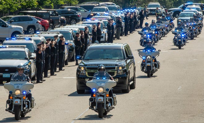 A procession of police vehicles escorts fallen Worcester Police Officer Enmanuel Familia from UMass Memorial Medical Center to the Office of the Chief Medical Examiner in Westfield on Saturday.