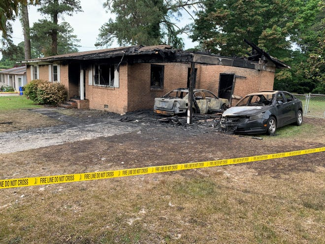 A fire early Saturday morning at 271 Decatur Drive displaced five people and destroyed the home and two cars shown here.