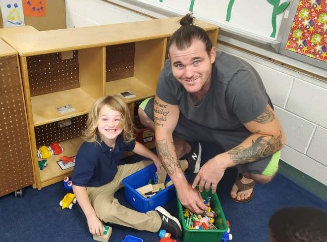 Justin Jackson visits his son Donald at pre-K  in 2019. Jackson was shot and killed Wednesday at his home by two men. His teen daughter was shot in the leg.