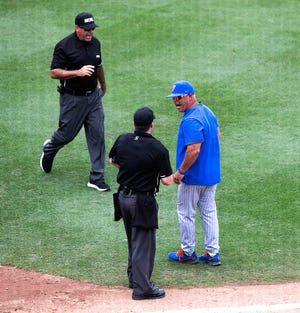 Florida coach Kevin O' Sullivan gets into it with the umpires during the sixth inning Saturday against South Alabama in the Gainesville Regional at Florida Ballpark.