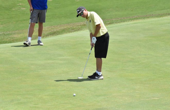 Springs Valley's Blake Albright putts on the sixth green during Friday's boys golf sectional in Jasper.