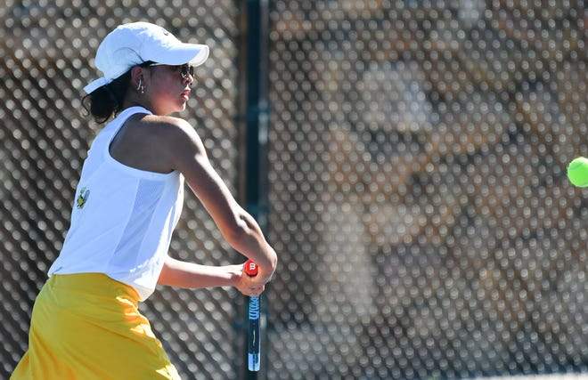 Pueblo East Malaya Pendon nails a backhand return in her matchup with Mesa Ridge's Mikayla Kollin. She won in back-to-back sets to clinch a state spot at City Park June 4, 2021.