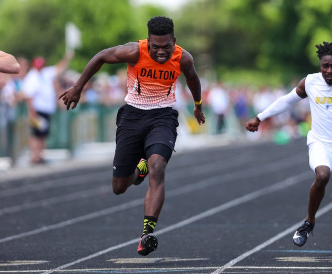 Dalton's Ozzie Miller crosses the finish line during the boys 100 meter dash at the state Division III track meet at Westerville North High School in Westerville, Ohio, on June 5, 2021. Miller won the event with a time of 10.98 sec.