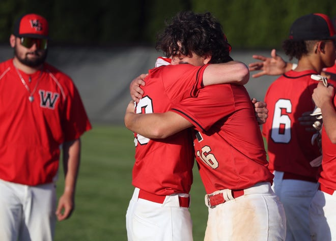 South's Logan Hunn (16) and Andrew Collinsworth console each other after an 8-7 loss to Olentangy Orange in a Division I regional semifinal June 4 at Dublin Coffman. The Wildcats earned their first districttitle and captured their first OCC championshipsince 1983.