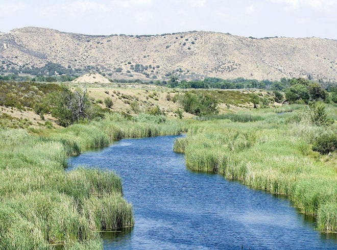 The West Fork of the Mojave River flows along the edge of the Tapestry residential project in Summit Valley.