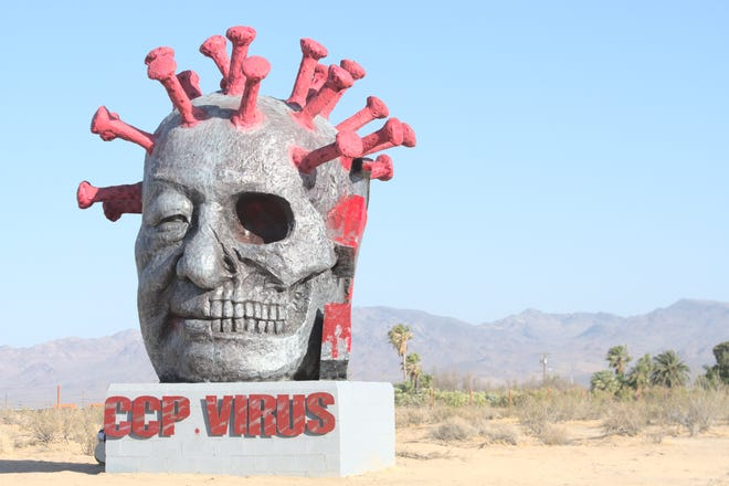"""""""CCP Virus,"""" artist Weiming Chen's critique of the Chinese government, was unveiled at Liberty Sculpture Park in Yermo on Friday, June 4, 2021."""