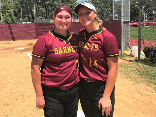Catcher Shannon McLaughlin, left, and pitcher Maddy Clark powered the Haddon Heights High School softball team to a 2-0 victory in a game that took two days to complete.