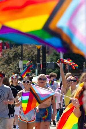 Marchers walk during the Hamilton Ohio Pride March in Hamilton this month.