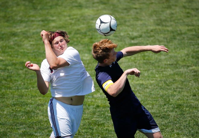 West Burlington-Notre Dame senior midfielder Sam Brueck, right, heads the ball up field in the first half against Hull-Western Christian during the Class 1A boys state soccer championship game on Saturday, June 5, 2021, at Cownie Field in Des Moines.