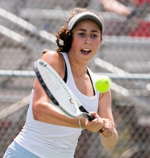 South Bend St. Joseph tennis player Molly Bellia hits a backhand Saturday, June 5, 2021, during the IHSAA tennis state finals in Indianapolis