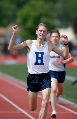 Hartland's Riley Hough wins the 3200 meter, Saturday, June 5, 2021, in East Kentwood, Mich.