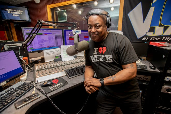 """Reggie Brown, in his V100 radio booth on June 4, is sharing why he chose to get a COVID-19 vaccine. """"I did it because my family did it and I'm always around my family and I want to keep them safe."""""""