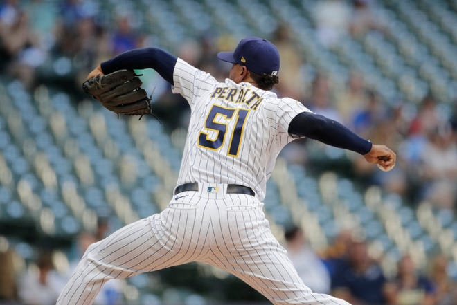 Milwaukee Brewers' Freddy Peralta pitches during the first inning of the team's baseball game against the Arizona Diamondbacks on Friday, June 4, 2021, in Milwaukee.