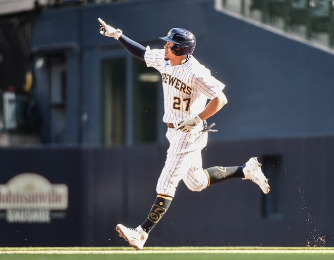Brewers shortstop Willy Adames rounds the bases after a two-run homer in the sixth inning Saturday.