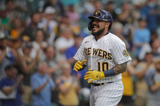 Brewers catcher Omar Narvaez smiles after scoring on two errors after he hit an RBI double.