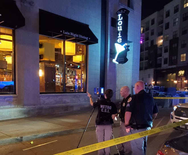 Police investigate after a fatal shooting outside Bar Louie in Nashville on Friday night.