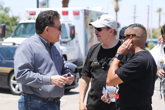 Las Cruces Mayor Ken Miyagishima (left) chats with Pastor Dave Vistine during the Burgers for Badges event on Saturday.