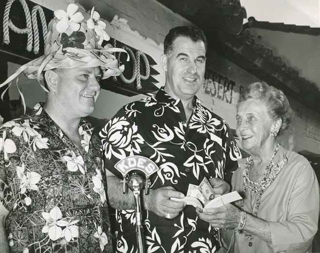 Ambassador of Aloha Waltah Clarke with Frank Bogert and philanthropist and socialite Elsinore Machris in front of Clarke's Hawaiian Shop on South Palm Canyon Drive, circa 1960.
