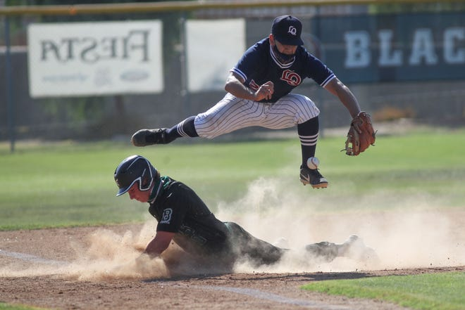 Abraham Hernandez jumps over the baserunner while trying to make a catch and tag for La Quinta in their loss against Bonita in the CIF playoffs, June 4, 2021.