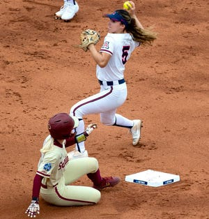 Arizona second baseman Reyna Carranco (5) gets out Florida State infielder Sydney Sherrill (24) at second base in the first inning of Arizona's game against Florida State during day three of the 2021 Women's College World Series at the USA Softball Hall of Fame Stadium in Oklahoma City on June 5, 2021. Arizona ended their season with a 4-3 loss against Florida State.