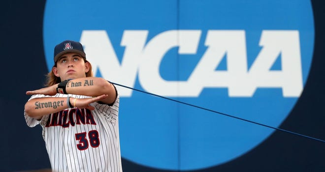 Arizona Riley Cooper gets in his pregame work Friday night. The Wildcats went on to beat Grand Canyon 12-6.