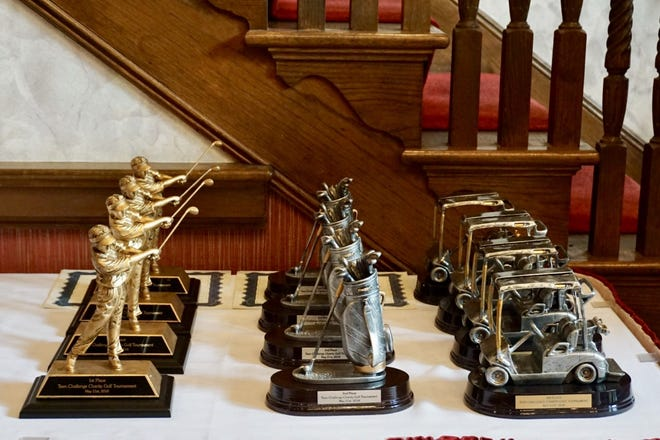 Trophies are awarded to the top performers during the Tallahassee Teen Charity Golf Tournament at Golden Eagle Golf Club.
