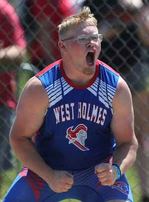 West Holmes' Lane Graham celebrates after a throw of 180 feet, 5 inches to win the boys discus throw event during the Division II OHSAA State Track and Field Tournament at Pickerington High School North on Saturday.