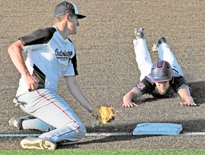 Bartlesville Doenges Ford Indians baserunner Josh Weber, right, slides into third during tourney action this weekend.