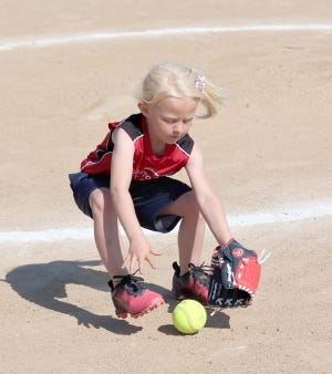 Autoworks Experts player Samantha Brengarth fields a ground ball in Babe Ruth 6Usoftball Saturday at Lions park. Autowork Experts defeated Monteer Plants &Baskets 6-3.