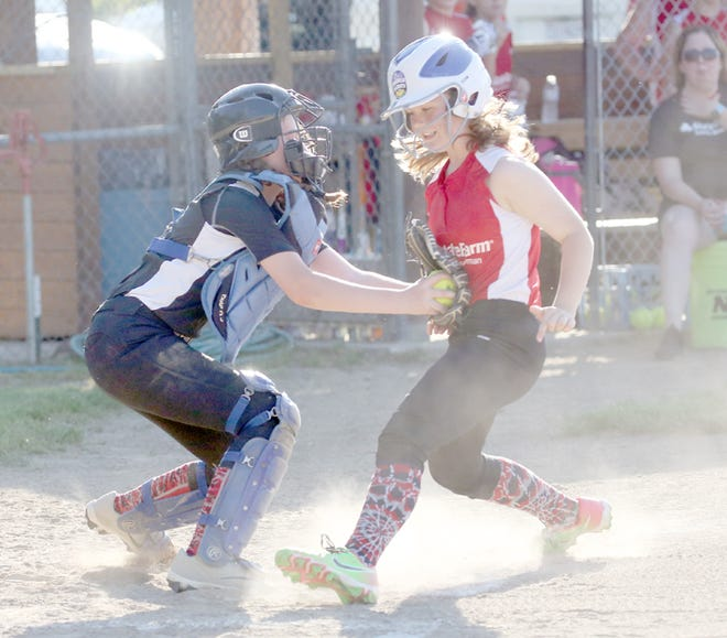 Rick Ball catcher Milly Waller applies the tag on State Farm's Karrman Leonard in the first inning Friday night in Babe Ruth 12U softball at Bill Simmons field at Rolling Hills park.